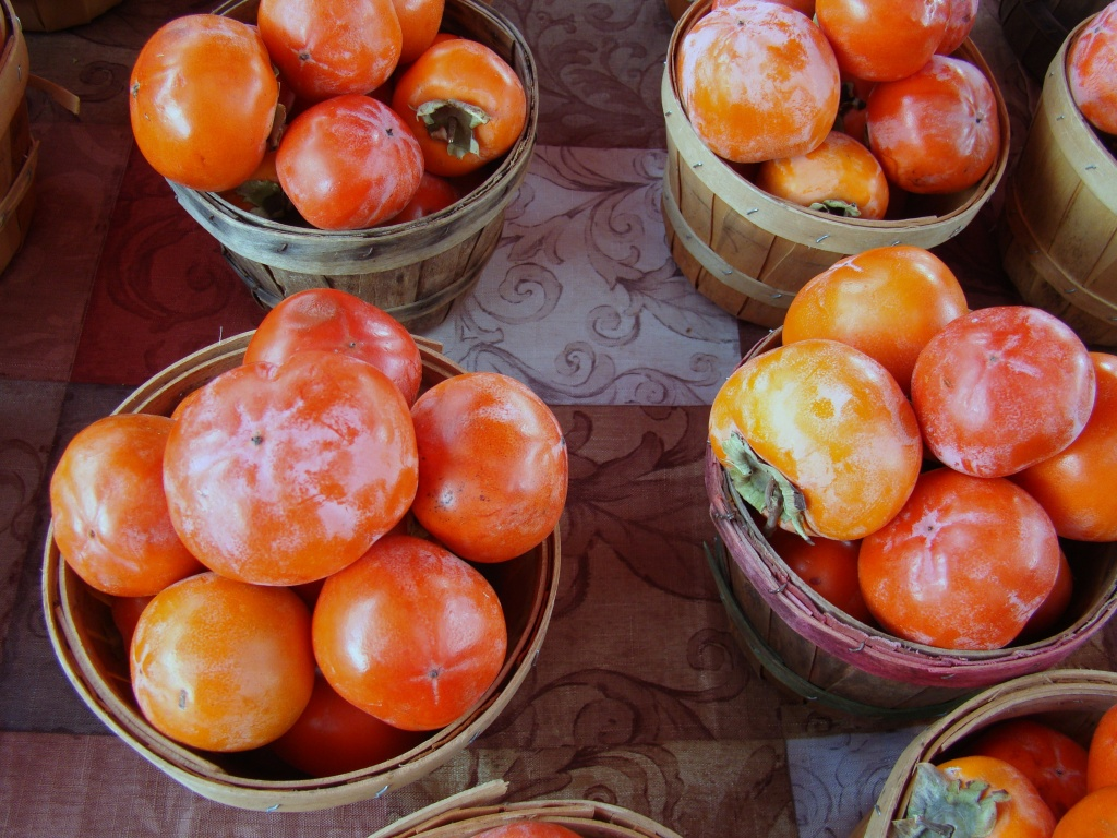 baskets of persimmons